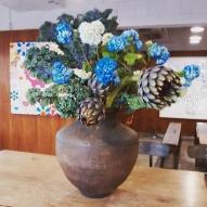 Flower arrangement, including whole artichokes