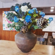 Flower arrangement, including whole artichokes